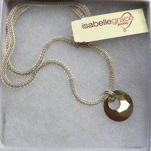 Necklace with Swarovski pendant on mesh chain.